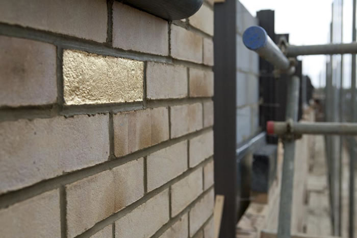 TRACE, 80 house bricks, gold leaf, 2013