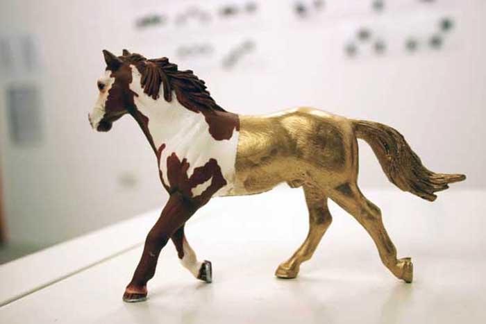 Secrets and Lies, plastic horse, gold leaf, 2010